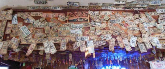 At Hank's favorite hang out, The Country Club Bar & Grill in Klamath Ca, 18 years of customer signature dollars over the bar surround a photo of the #98, of Hank Hilton.