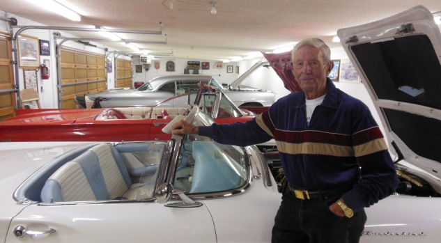Harold and some of his collector cars; a Thunderbird in the foreground and a '57 Oldsmobile in the back